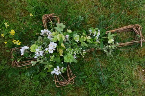 Seasonal British Willow funeral cross with apple blossom in York and Hull