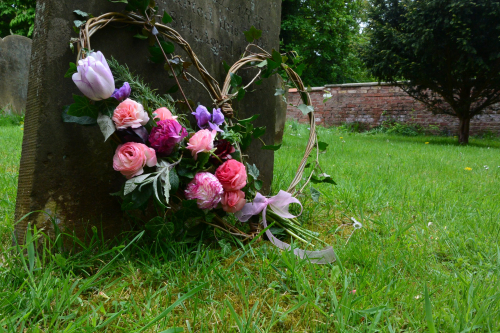 Seasonal British Willow funeral heart with Ranunculus in York and Hull
