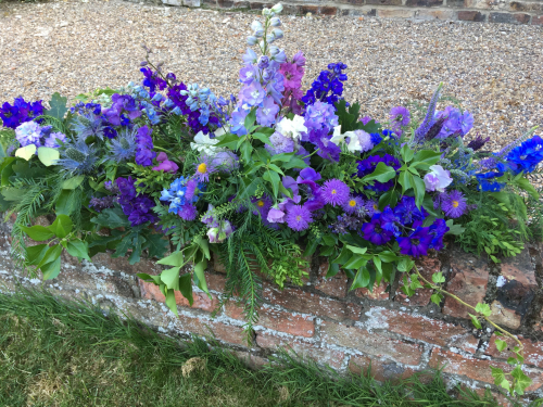 Seasonal British summer blues funeral flowers - double ended spray in York and Hull
