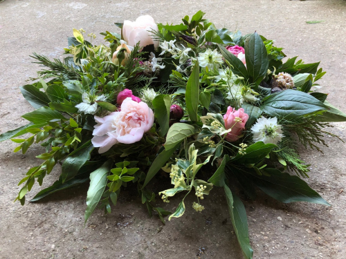 Seasonal British Green funeral wreath with a few pink Peonies in York and Hull