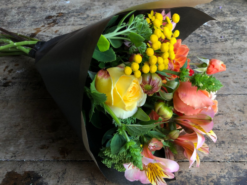 Seasonal British Wrapped funeral sympathy bouquet of British flowers in York and Hull