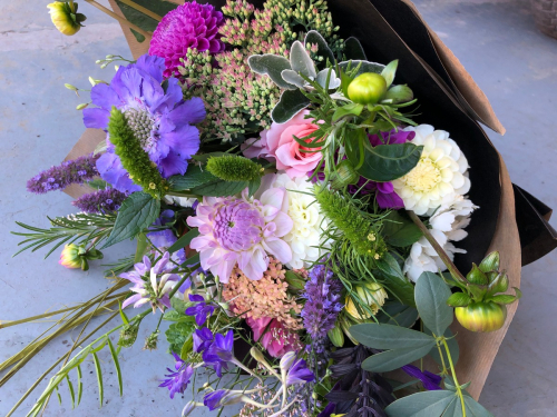 Seasonal Wrapped funeral sympathy bouquet of British flowers in York and Hull