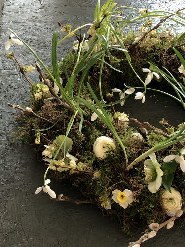 Seasonal British Mossed funeral wreath with spring bulbs in York and Hull