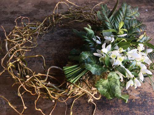 Seasonal British funeral wreath of snowdrops in York and Hull