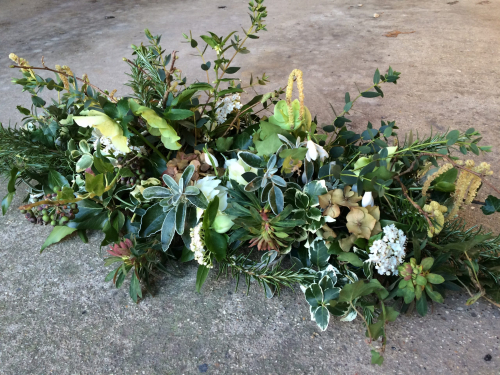 Seasonal British February funeral flowers - a double ended sheaf in York and Hull