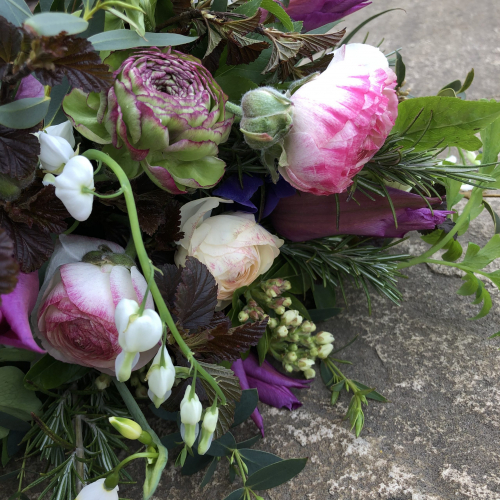Seasonal British Ranunculus and white Bleeding Heart funeral flowers in York and Hull